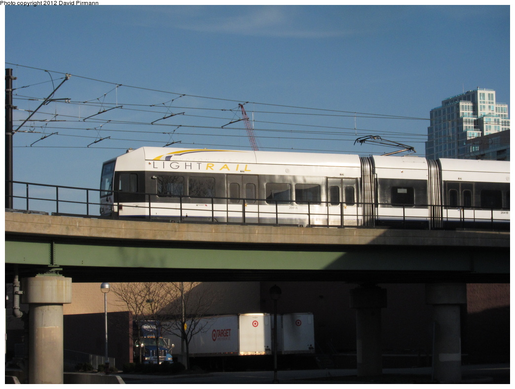 (246k, 1044x788)<br><b>Country:</b> United States<br><b>City:</b> Jersey City, NJ<br><b>System:</b> Hudson Bergen Light Rail<br><b>Location:</b> Between Newport & Hoboken <br><b>Car:</b> NJT-HBLR LRV (Kinki-Sharyo, 1998-99)  2041 <br><b>Photo by:</b> David Pirmann<br><b>Date:</b> 3/7/2012<br><b>Viewed (this week/total):</b> 0 / 92
