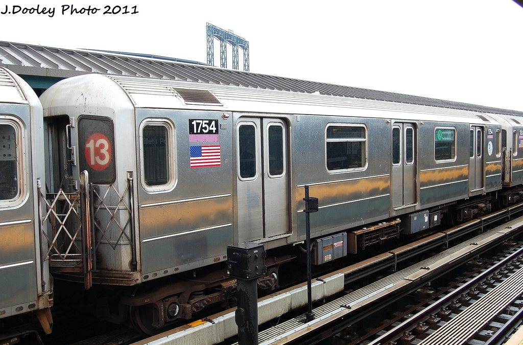 (340k, 1024x675)<br><b>Country:</b> United States<br><b>City:</b> New York<br><b>System:</b> New York City Transit<br><b>Line:</b> IRT Flushing Line<br><b>Location:</b> Willets Point/Mets (fmr. Shea Stadium) <br><b>Route:</b> 7<br><b>Car:</b> R-62A (Bombardier, 1984-1987)  1754 <br><b>Photo by:</b> John Dooley<br><b>Date:</b> 9/20/2011<br><b>Viewed (this week/total):</b> 0 / 400