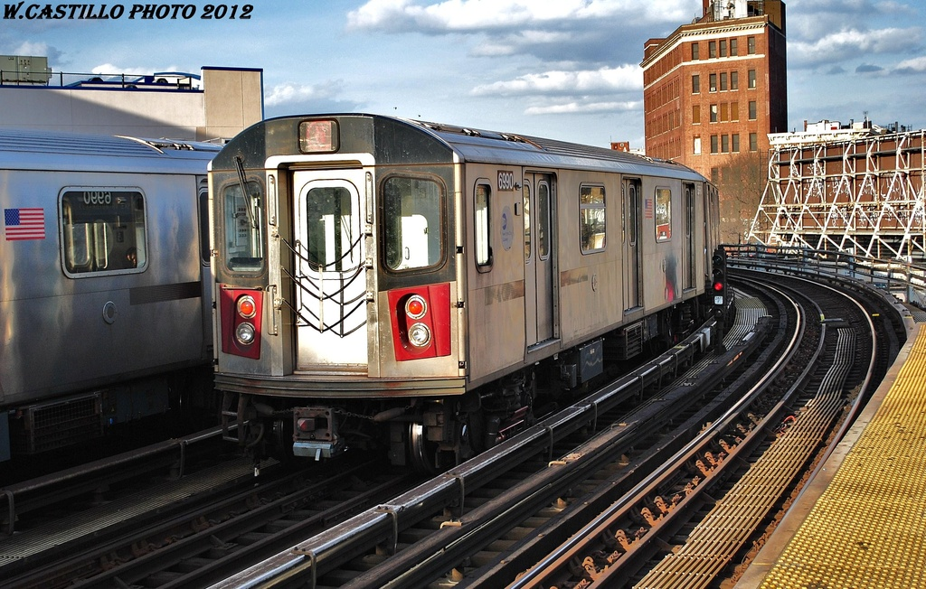 (371k, 1024x652)<br><b>Country:</b> United States<br><b>City:</b> New York<br><b>System:</b> New York City Transit<br><b>Line:</b> IRT White Plains Road Line<br><b>Location:</b> Simpson Street <br><b>Route:</b> 5<br><b>Car:</b> R-142 (Option Order, Bombardier, 2002-2003)  6990 <br><b>Photo by:</b> Wilfredo Castillo<br><b>Date:</b> 3/8/2012<br><b>Viewed (this week/total):</b> 1 / 350