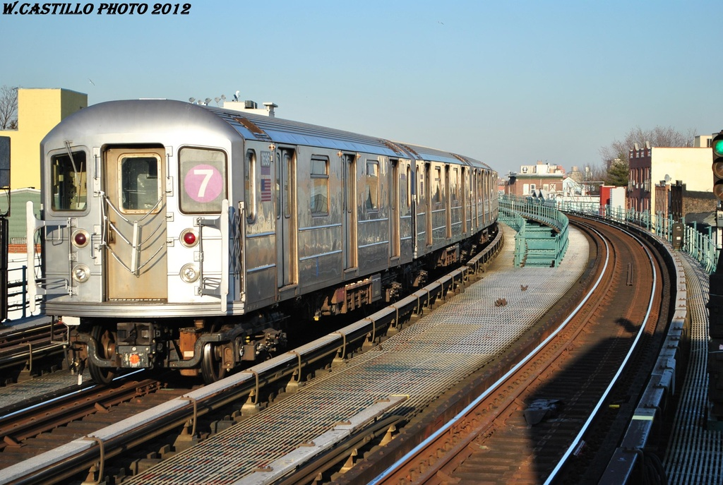 (332k, 1024x687)<br><b>Country:</b> United States<br><b>City:</b> New York<br><b>System:</b> New York City Transit<br><b>Line:</b> IRT Flushing Line<br><b>Location:</b> 103rd Street/Corona Plaza <br><b>Route:</b> 7<br><b>Car:</b> R-62A (Bombardier, 1984-1987)  1696 <br><b>Photo by:</b> Wilfredo Castillo<br><b>Date:</b> 3/6/2012<br><b>Viewed (this week/total):</b> 0 / 964