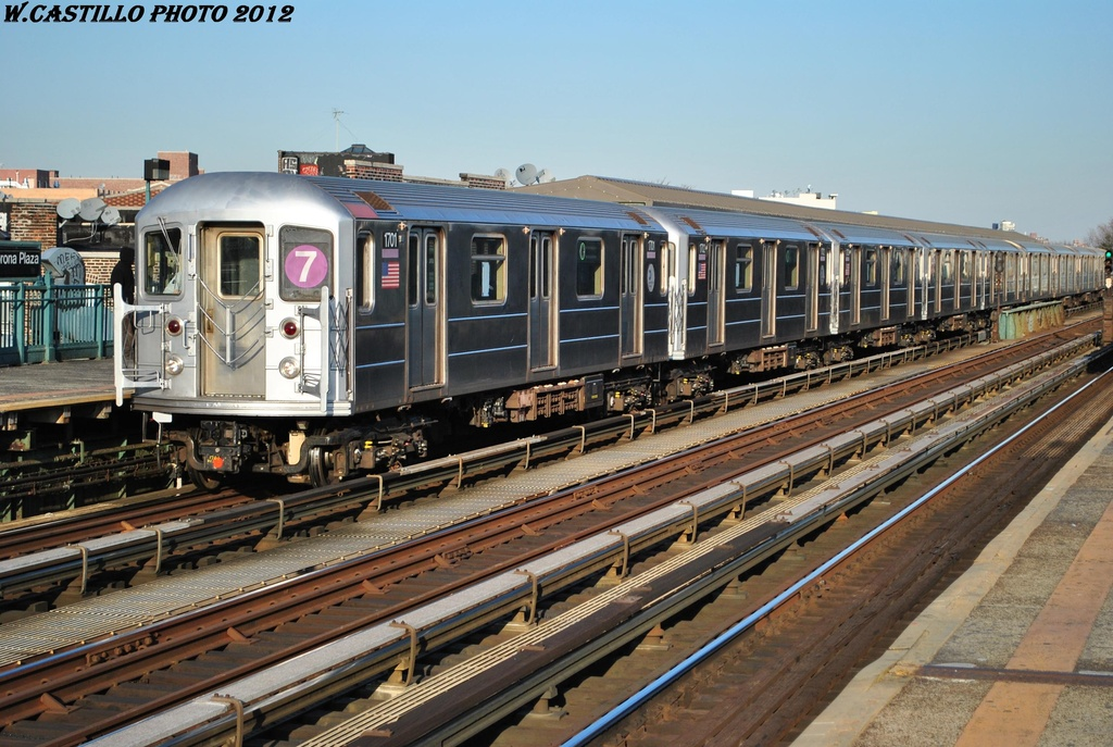 (338k, 1024x687)<br><b>Country:</b> United States<br><b>City:</b> New York<br><b>System:</b> New York City Transit<br><b>Line:</b> IRT Flushing Line<br><b>Location:</b> 103rd Street/Corona Plaza <br><b>Route:</b> 7<br><b>Car:</b> R-62A (Bombardier, 1984-1987)  1701 <br><b>Photo by:</b> Wilfredo Castillo<br><b>Date:</b> 3/6/2012<br><b>Viewed (this week/total):</b> 4 / 864