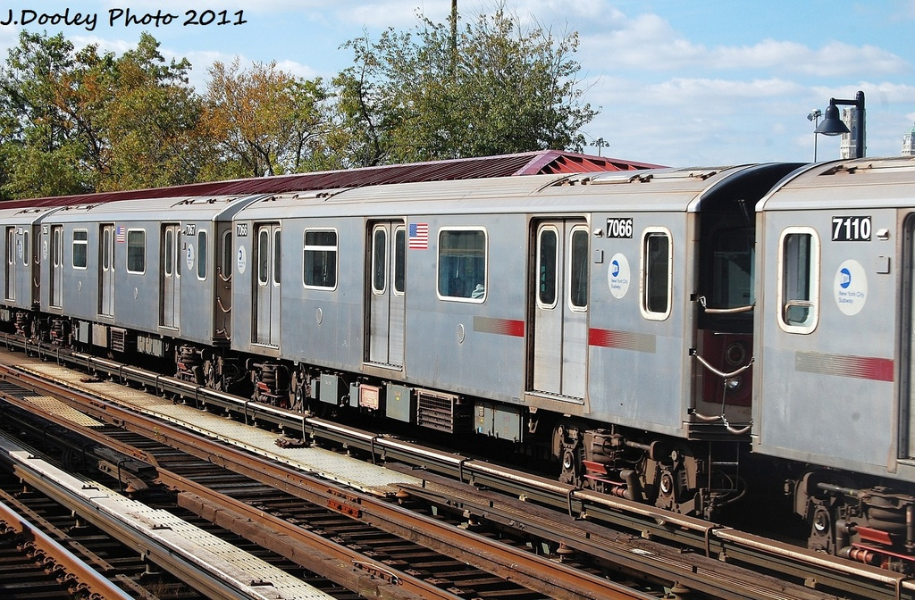 (419k, 1024x672)<br><b>Country:</b> United States<br><b>City:</b> New York<br><b>System:</b> New York City Transit<br><b>Line:</b> IRT Woodlawn Line<br><b>Location:</b> Bedford Park Boulevard <br><b>Route:</b> 4<br><b>Car:</b> R-142 (Option Order, Bombardier, 2002-2003)  7066 <br><b>Photo by:</b> John Dooley<br><b>Date:</b> 10/23/2011<br><b>Viewed (this week/total):</b> 5 / 433