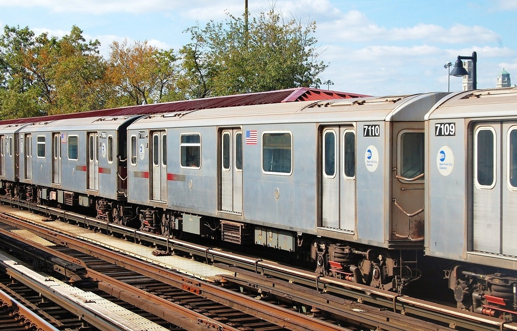 (397k, 1024x656)<br><b>Country:</b> United States<br><b>City:</b> New York<br><b>System:</b> New York City Transit<br><b>Line:</b> IRT Woodlawn Line<br><b>Location:</b> Bedford Park Boulevard <br><b>Route:</b> 4<br><b>Car:</b> R-142 (Option Order, Bombardier, 2002-2003)  7110 <br><b>Photo by:</b> John Dooley<br><b>Date:</b> 10/23/2011<br><b>Viewed (this week/total):</b> 0 / 214