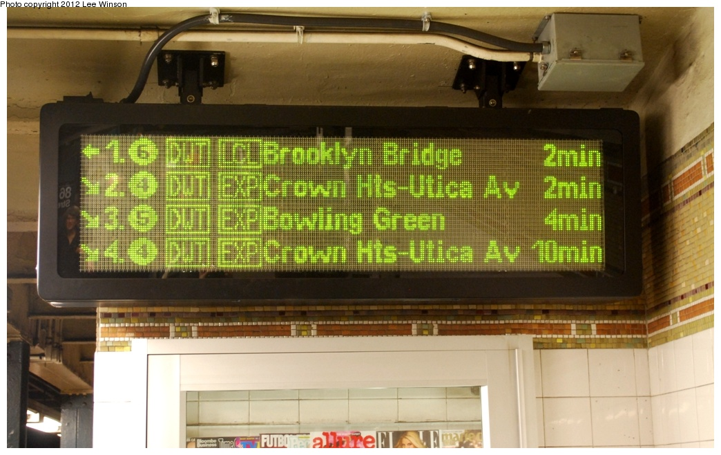 (282k, 1044x658)<br><b>Country:</b> United States<br><b>City:</b> New York<br><b>System:</b> New York City Transit<br><b>Line:</b> IRT East Side Line<br><b>Location:</b> 86th Street <br><b>Photo by:</b> Lee Winson<br><b>Date:</b> 3/18/2012<br><b>Notes:</b> IRT Lexington Ave, 86th Street downtown, local platform, waiting time sign.  Arrows point to appropriate platform for train. <br><b>Viewed (this week/total):</b> 3 / 831