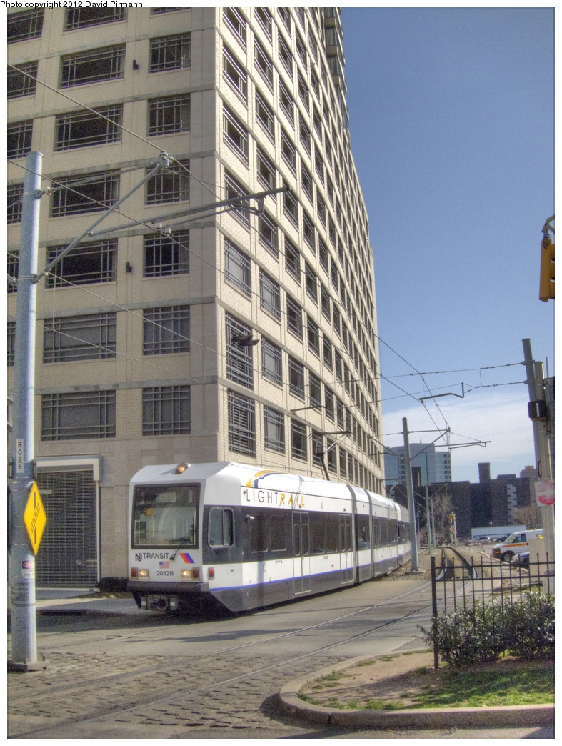 (348k, 787x1044)<br><b>Country:</b> United States<br><b>City:</b> Jersey City, NJ<br><b>System:</b> Hudson Bergen Light Rail<br><b>Location:</b> 6th St. Grade Crossing <br><b>Car:</b> NJT-HBLR LRV (Kinki-Sharyo, 1998-99)  2032 <br><b>Photo by:</b> David Pirmann<br><b>Date:</b> 3/14/2012<br><b>Viewed (this week/total):</b> 2 / 87
