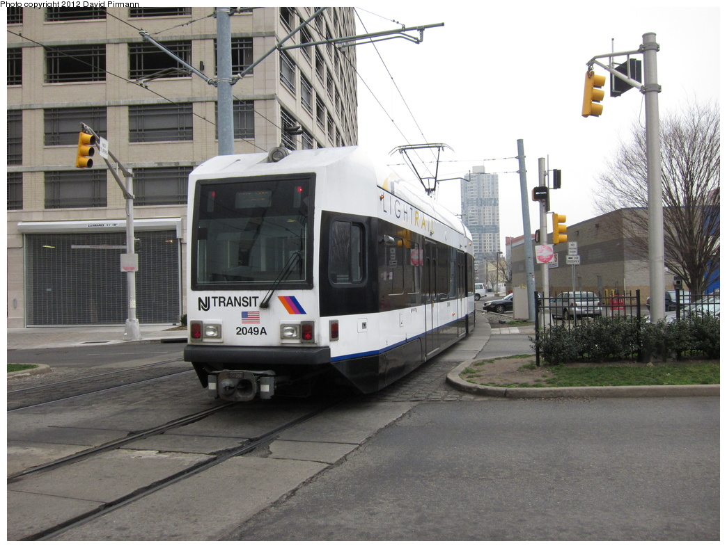 (325k, 1044x788)<br><b>Country:</b> United States<br><b>City:</b> Jersey City, NJ<br><b>System:</b> Hudson Bergen Light Rail<br><b>Location:</b> 6th St. Grade Crossing <br><b>Car:</b> NJT-HBLR LRV (Kinki-Sharyo, 1998-99)  2049 <br><b>Photo by:</b> David Pirmann<br><b>Date:</b> 3/18/2012<br><b>Viewed (this week/total):</b> 1 / 240