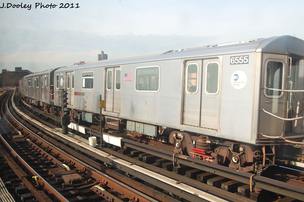 (319k, 1024x681)<br><b>Country:</b> United States<br><b>City:</b> New York<br><b>System:</b> New York City Transit<br><b>Line:</b> IRT White Plains Road Line<br><b>Location:</b> East 180th Street <br><b>Route:</b> 5<br><b>Car:</b> R-142 (Primary Order, Bombardier, 1999-2002)  6555 <br><b>Photo by:</b> John Dooley<br><b>Date:</b> 11/14/2011<br><b>Viewed (this week/total):</b> 7 / 429