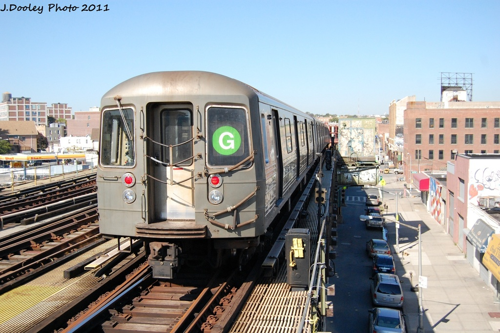 (326k, 1024x681)<br><b>Country:</b> United States<br><b>City:</b> New York<br><b>System:</b> New York City Transit<br><b>Line:</b> BMT Culver Line<br><b>Location:</b> Ditmas Avenue <br><b>Route:</b> G<br><b>Car:</b> R-68 (Westinghouse-Amrail, 1986-1988)  2910 <br><b>Photo by:</b> John Dooley<br><b>Date:</b> 10/9/2011<br><b>Viewed (this week/total):</b> 3 / 322