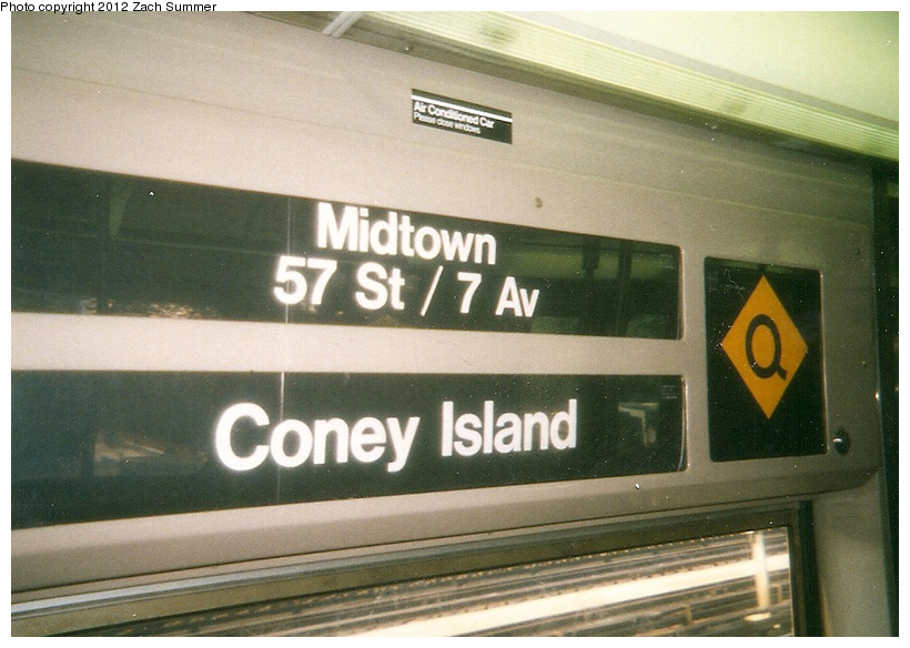 (229k, 820x584)<br><b>Country:</b> United States<br><b>City:</b> New York<br><b>System:</b> New York City Transit<br><b>Route:</b> Q<br><b>Car:</b> R-68 (Westinghouse-Amrail, 1986-1988)  Interior <br><b>Photo by:</b> Zach Summer<br><b>Date:</b> 7/22/2001<br><b>Notes:</b> New (Q) Local Rollsign using the original diamond-Q sign. First Day of Broadway Express/Brighton Local (Q) Service<br><b>Viewed (this week/total):</b> 0 / 741
