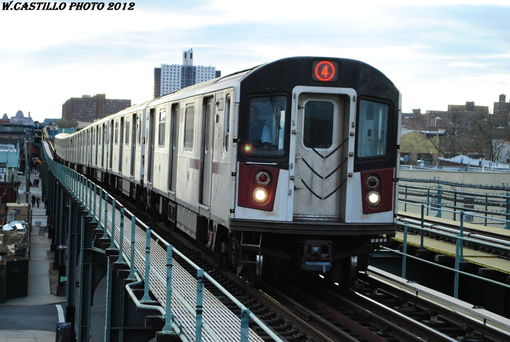 (285k, 1024x687)<br><b>Country:</b> United States<br><b>City:</b> New York<br><b>System:</b> New York City Transit<br><b>Line:</b> IRT Brooklyn Line<br><b>Location:</b> Van Siclen Avenue <br><b>Route:</b> 4<br><b>Car:</b> R-142A (Supplemental Order, Kawasaki, 2003-2004)  7801 <br><b>Photo by:</b> Wilfredo Castillo<br><b>Date:</b> 3/29/2012<br><b>Viewed (this week/total):</b> 0 / 264