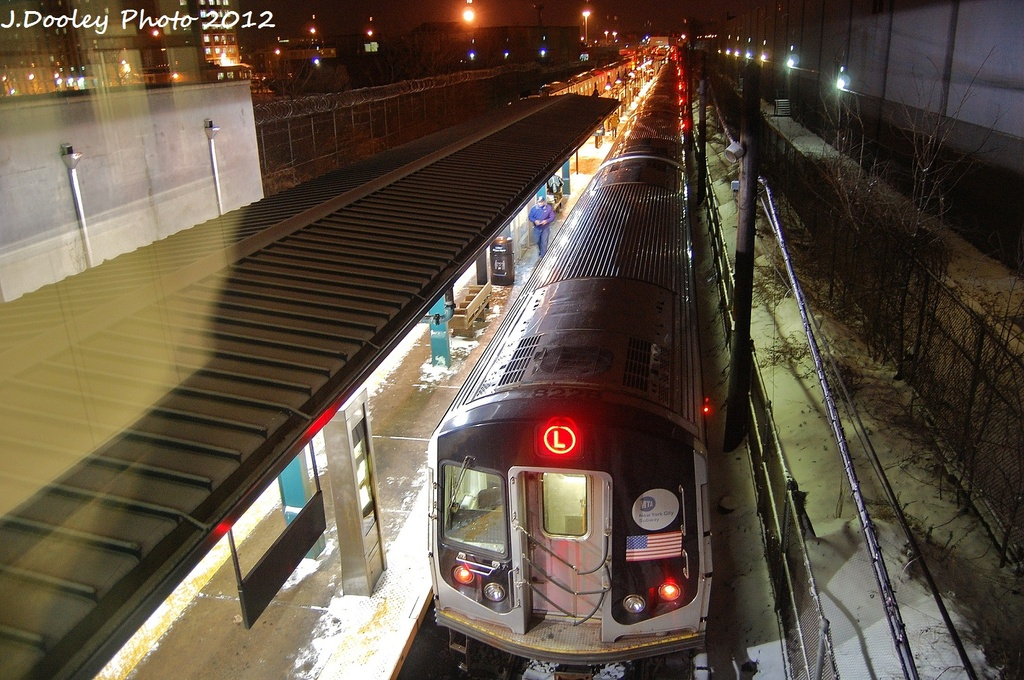 (372k, 1024x680)<br><b>Country:</b> United States<br><b>City:</b> New York<br><b>System:</b> New York City Transit<br><b>Line:</b> BMT Canarsie Line<br><b>Location:</b> East 105th Street <br><b>Route:</b> L<br><b>Car:</b> R-143 (Kawasaki, 2001-2002) 8228 <br><b>Photo by:</b> John Dooley<br><b>Date:</b> 1/21/2012<br><b>Viewed (this week/total):</b> 0 / 422