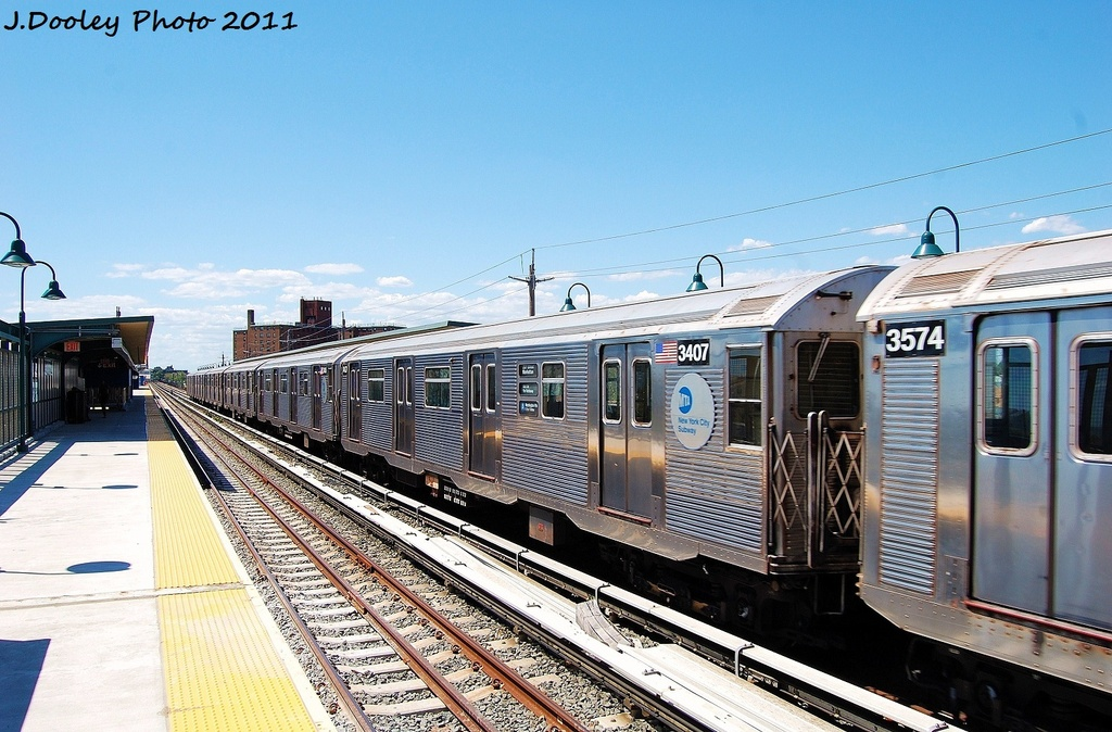 (349k, 1024x674)<br><b>Country:</b> United States<br><b>City:</b> New York<br><b>System:</b> New York City Transit<br><b>Line:</b> IND Rockaway<br><b>Location:</b> Beach 67th Street/Gaston Avenue <br><b>Route:</b> A<br><b>Car:</b> R-32 (Budd, 1964)  3407 <br><b>Photo by:</b> John Dooley<br><b>Date:</b> 8/11/2011<br><b>Viewed (this week/total):</b> 4 / 112