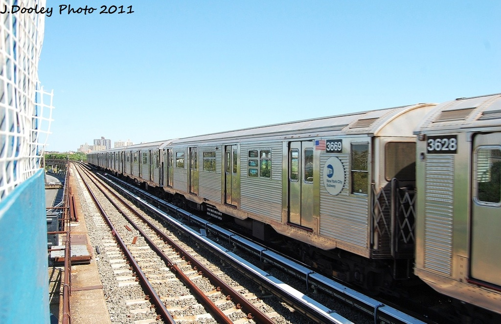 (316k, 1024x662)<br><b>Country:</b> United States<br><b>City:</b> New York<br><b>System:</b> New York City Transit<br><b>Line:</b> IND Rockaway<br><b>Location:</b> Beach 44th Street/Frank Avenue <br><b>Route:</b> A<br><b>Car:</b> R-32 (Budd, 1964)  3669 <br><b>Photo by:</b> John Dooley<br><b>Date:</b> 8/11/2011<br><b>Viewed (this week/total):</b> 1 / 127