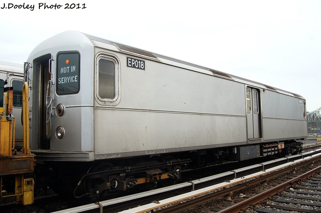 (279k, 1024x680)<br><b>Country:</b> United States<br><b>City:</b> New York<br><b>System:</b> New York City Transit<br><b>Location:</b> 207th Street Yard<br><b>Car:</b> R-127/R-134 (Kawasaki, 1991-1996) EP018 <br><b>Photo by:</b> John Dooley<br><b>Date:</b> 11/29/2011<br><b>Viewed (this week/total):</b> 4 / 450