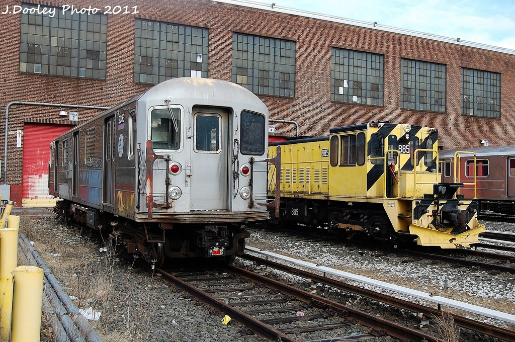 (483k, 1024x680)<br><b>Country:</b> United States<br><b>City:</b> New York<br><b>System:</b> New York City Transit<br><b>Location:</b> 207th Street Yard<br><b>Car:</b> R-62A (Bombardier, 1984-1987)  2033 <br><b>Photo by:</b> John Dooley<br><b>Date:</b> 11/29/2011<br><b>Notes:</b> With loco 885<br><b>Viewed (this week/total):</b> 4 / 259