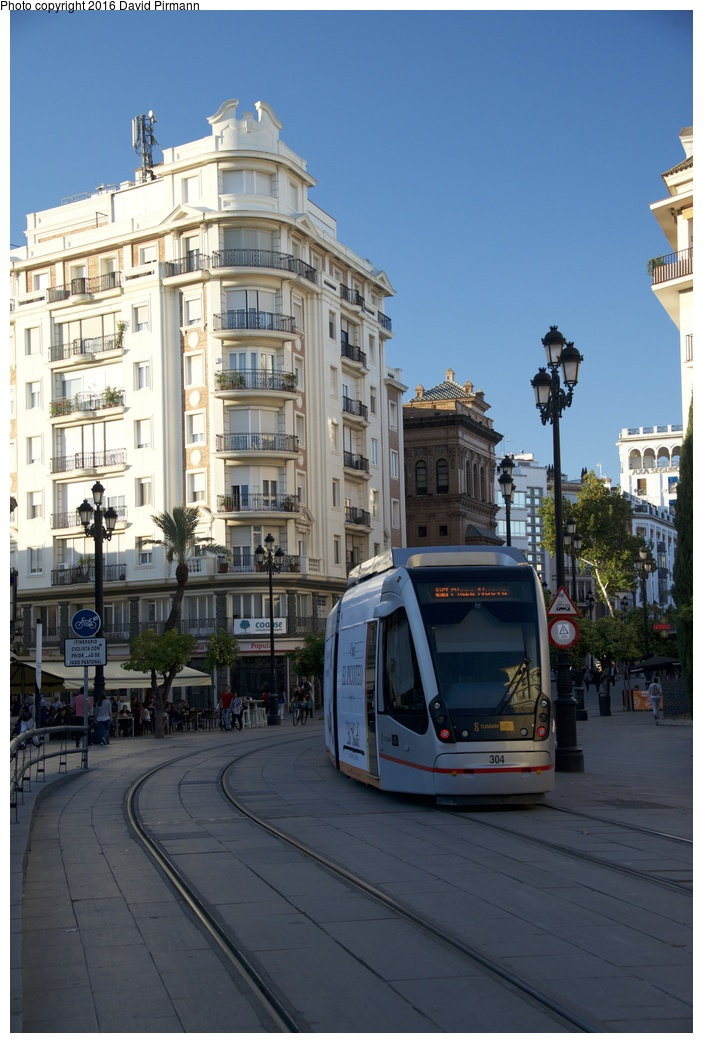(239k, 703x1043)<br><b>Country:</b> Spain<br><b>City:</b> Seville<br><b>System:</b> Tranvía MetroCentro <br><b>Location:</b> <b>Puerta de Jerez</b> <br><b>Car:</b> CAF Urbos 3  304 <br><b>Photo by:</b> David Pirmann<br><b>Date:</b> 11/9/2015<br><b>Viewed (this week/total):</b> 2 / 355
