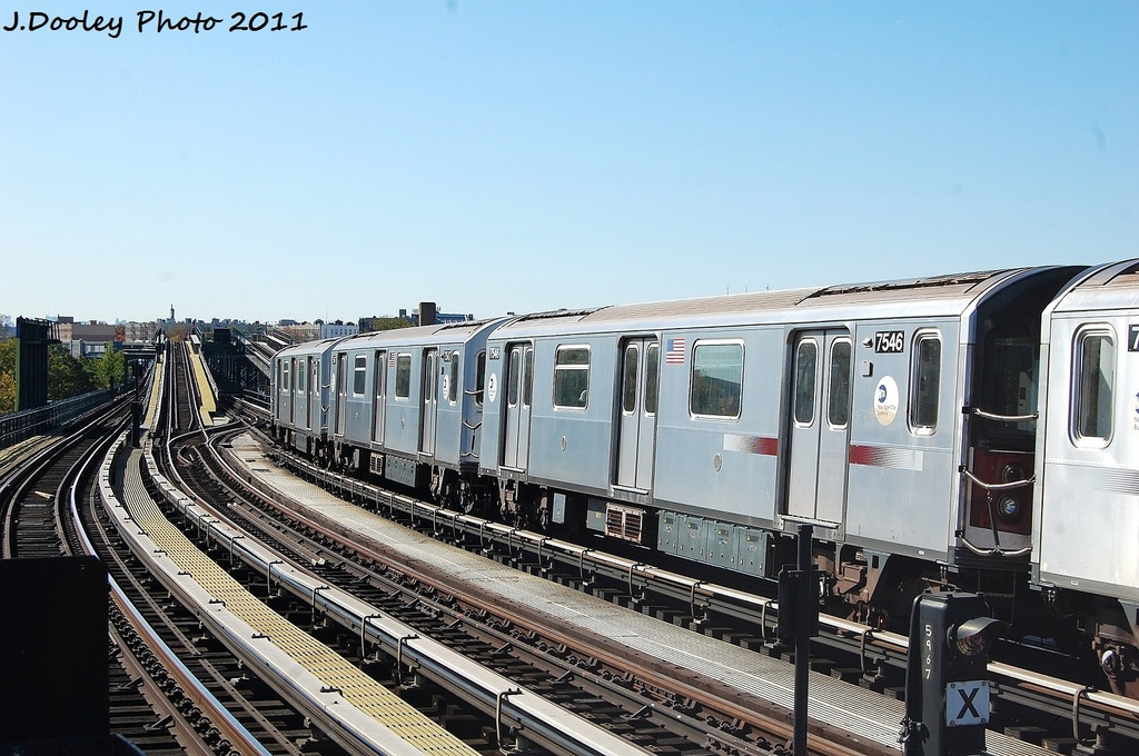 (335k, 1024x680)<br><b>Country:</b> United States<br><b>City:</b> New York<br><b>System:</b> New York City Transit<br><b>Line:</b> IRT Pelham Line<br><b>Location:</b> Middletown Road <br><b>Route:</b> 6<br><b>Car:</b> R-142A (Primary Order, Kawasaki, 1999-2002)  7546 <br><b>Photo by:</b> John Dooley<br><b>Date:</b> 11/5/2011<br><b>Viewed (this week/total):</b> 0 / 204