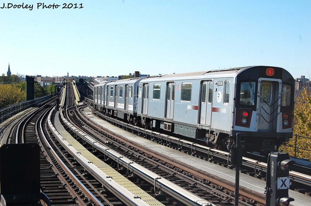 (366k, 1024x680)<br><b>Country:</b> United States<br><b>City:</b> New York<br><b>System:</b> New York City Transit<br><b>Line:</b> IRT Pelham Line<br><b>Location:</b> Middletown Road <br><b>Route:</b> 6<br><b>Car:</b> R-142A (Primary Order, Kawasaki, 1999-2002)  7606 <br><b>Photo by:</b> John Dooley<br><b>Date:</b> 11/5/2011<br><b>Viewed (this week/total):</b> 0 / 512
