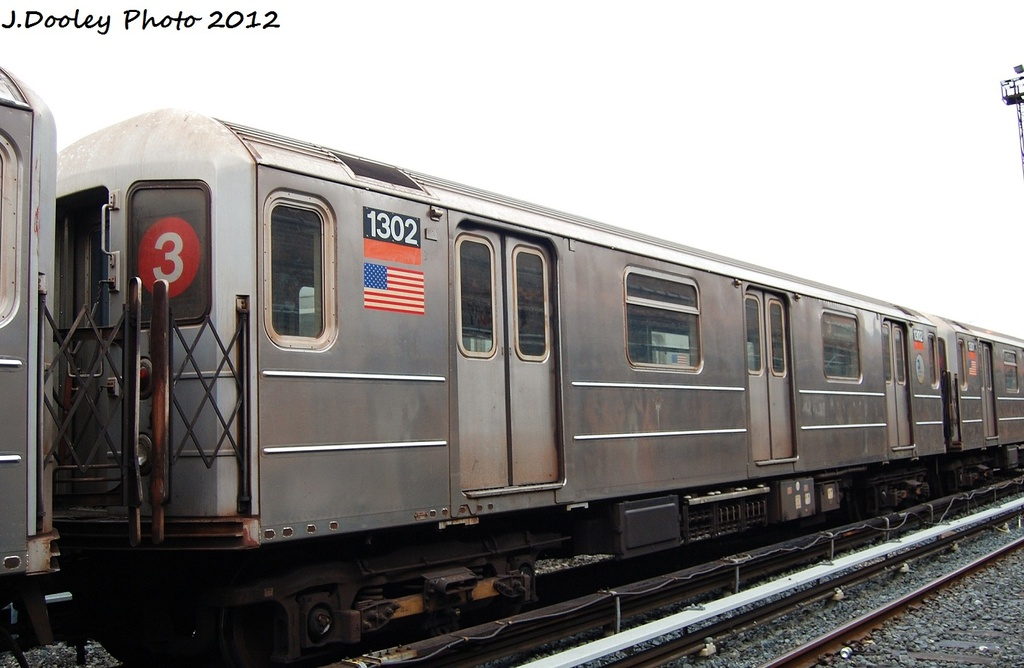 (252k, 1024x668)<br><b>Country:</b> United States<br><b>City:</b> New York<br><b>System:</b> New York City Transit<br><b>Location:</b> Livonia Yard<br><b>Car:</b> R-62 (Kawasaki, 1983-1985)  1302 <br><b>Photo by:</b> John Dooley<br><b>Date:</b> 1/26/2012<br><b>Viewed (this week/total):</b> 4 / 1047