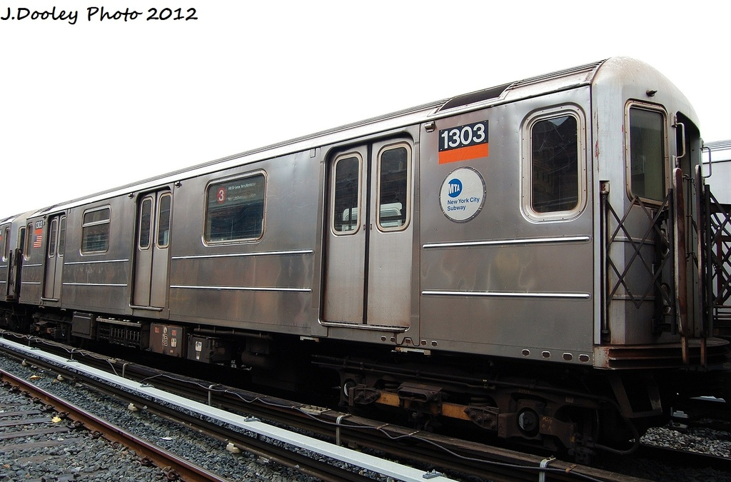(283k, 1024x675)<br><b>Country:</b> United States<br><b>City:</b> New York<br><b>System:</b> New York City Transit<br><b>Location:</b> Livonia Yard<br><b>Car:</b> R-62 (Kawasaki, 1983-1985)  1303 <br><b>Photo by:</b> John Dooley<br><b>Date:</b> 1/26/2012<br><b>Viewed (this week/total):</b> 0 / 258