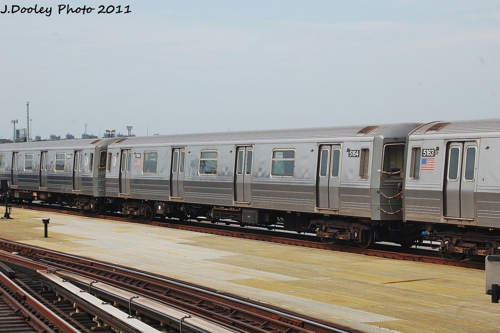 (310k, 1024x681)<br><b>Country:</b> United States<br><b>City:</b> New York<br><b>System:</b> New York City Transit<br><b>Location:</b> Coney Island/Stillwell Avenue<br><b>Route:</b> N<br><b>Car:</b> R-68A (Kawasaki, 1988-1989)  5164 <br><b>Photo by:</b> John Dooley<br><b>Date:</b> 7/23/2011<br><b>Viewed (this week/total):</b> 3 / 107