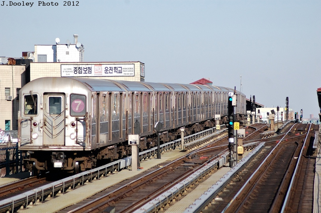 (340k, 1024x680)<br><b>Country:</b> United States<br><b>City:</b> New York<br><b>System:</b> New York City Transit<br><b>Line:</b> IRT Flushing Line<br><b>Location:</b> 69th Street/Fisk Avenue <br><b>Route:</b> 7<br><b>Car:</b> R-62A (Bombardier, 1984-1987)   <br><b>Photo by:</b> John Dooley<br><b>Date:</b> 3/6/2012<br><b>Viewed (this week/total):</b> 2 / 259