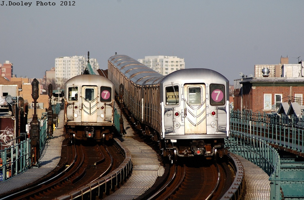 (360k, 1024x674)<br><b>Country:</b> United States<br><b>City:</b> New York<br><b>System:</b> New York City Transit<br><b>Line:</b> IRT Flushing Line<br><b>Location:</b> 103rd Street/Corona Plaza <br><b>Route:</b> 7<br><b>Car:</b> R-62A (Bombardier, 1984-1987)  1900 <br><b>Photo by:</b> John Dooley<br><b>Date:</b> 3/6/2012<br><b>Viewed (this week/total):</b> 0 / 1130