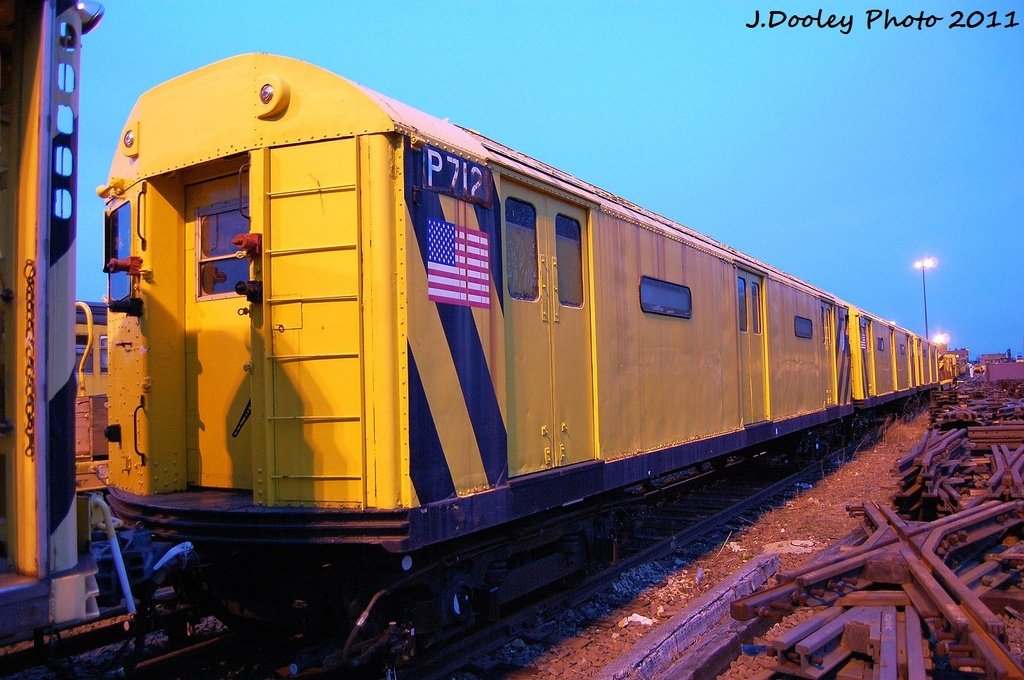 (330k, 1024x680)<br><b>Country:</b> United States<br><b>City:</b> New York<br><b>System:</b> New York City Transit<br><b>Location:</b> 36th Street Yard<br><b>Car:</b> R-71 Pump/Reach Car (R-17/R-21/R-22 Rebuilds) P7121 <br><b>Photo by:</b> John Dooley<br><b>Date:</b> 12/29/2011<br><b>Viewed (this week/total):</b> 2 / 296