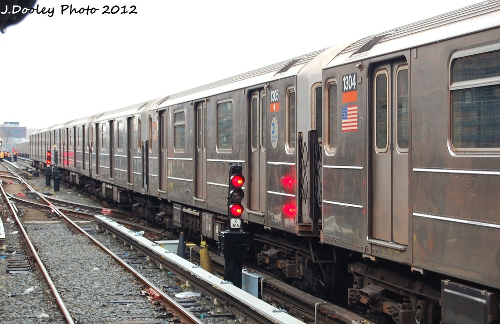 (293k, 1024x663)<br><b>Country:</b> United States<br><b>City:</b> New York<br><b>System:</b> New York City Transit<br><b>Location:</b> Livonia Yard<br><b>Car:</b> R-62 (Kawasaki, 1983-1985)  1305 <br><b>Photo by:</b> John Dooley<br><b>Date:</b> 1/26/2012<br><b>Viewed (this week/total):</b> 0 / 764