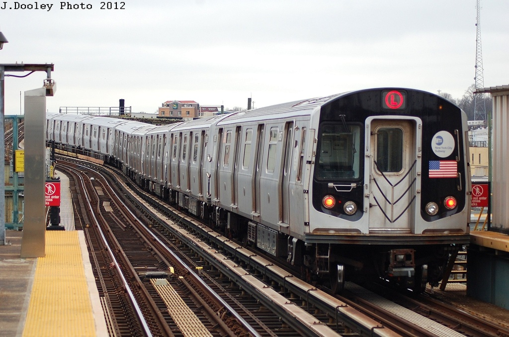 (316k, 1024x677)<br><b>Country:</b> United States<br><b>City:</b> New York<br><b>System:</b> New York City Transit<br><b>Line:</b> BMT Canarsie Line<br><b>Location:</b> Sutter Avenue <br><b>Route:</b> L<br><b>Car:</b> R-143 (Kawasaki, 2001-2002) 8157 <br><b>Photo by:</b> John Dooley<br><b>Date:</b> 3/15/2012<br><b>Viewed (this week/total):</b> 1 / 187