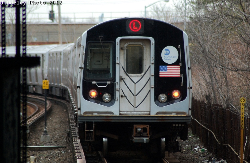 (303k, 1024x668)<br><b>Country:</b> United States<br><b>City:</b> New York<br><b>System:</b> New York City Transit<br><b>Line:</b> BMT Canarsie Line<br><b>Location:</b> East 105th Street <br><b>Route:</b> L<br><b>Car:</b> R-143 (Kawasaki, 2001-2002) 8184 <br><b>Photo by:</b> John Dooley<br><b>Date:</b> 3/15/2012<br><b>Viewed (this week/total):</b> 0 / 238