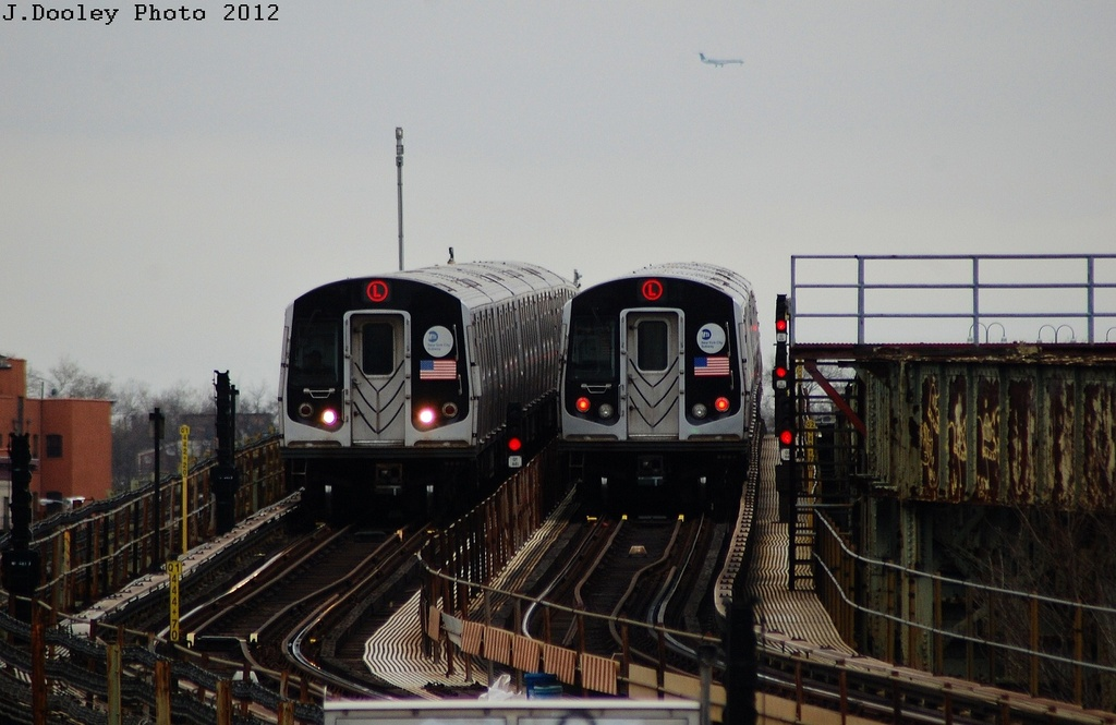 (272k, 1024x665)<br><b>Country:</b> United States<br><b>City:</b> New York<br><b>System:</b> New York City Transit<br><b>Line:</b> BMT Canarsie Line<br><b>Location:</b> Sutter Avenue <br><b>Route:</b> L<br><b>Car:</b> R-143 (Kawasaki, 2001-2002) 8221 <br><b>Photo by:</b> John Dooley<br><b>Date:</b> 3/15/2012<br><b>Viewed (this week/total):</b> 0 / 317