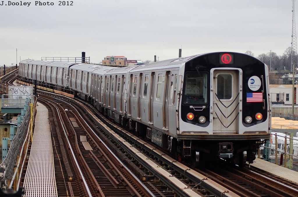 (348k, 1024x677)<br><b>Country:</b> United States<br><b>City:</b> New York<br><b>System:</b> New York City Transit<br><b>Line:</b> BMT Canarsie Line<br><b>Location:</b> Sutter Avenue <br><b>Route:</b> L<br><b>Car:</b> R-143 (Kawasaki, 2001-2002) 8249 <br><b>Photo by:</b> John Dooley<br><b>Date:</b> 3/15/2012<br><b>Viewed (this week/total):</b> 0 / 568