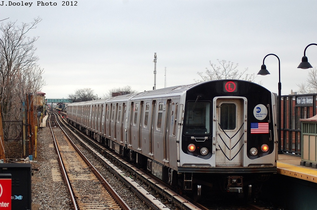 (332k, 1024x680)<br><b>Country:</b> United States<br><b>City:</b> New York<br><b>System:</b> New York City Transit<br><b>Line:</b> BMT Canarsie Line<br><b>Location:</b> New Lots Avenue <br><b>Route:</b> L<br><b>Car:</b> R-143 (Kawasaki, 2001-2002) 8253 <br><b>Photo by:</b> John Dooley<br><b>Date:</b> 3/15/2012<br><b>Viewed (this week/total):</b> 2 / 224
