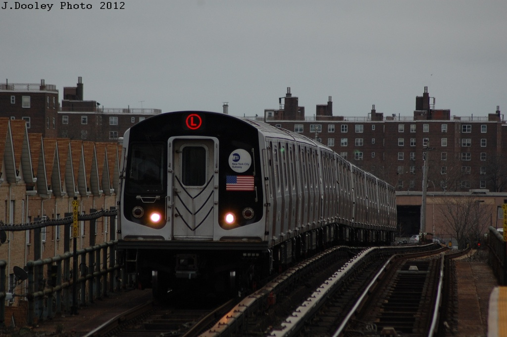 (223k, 1024x680)<br><b>Country:</b> United States<br><b>City:</b> New York<br><b>System:</b> New York City Transit<br><b>Line:</b> BMT Canarsie Line<br><b>Location:</b> New Lots Avenue <br><b>Route:</b> L<br><b>Car:</b> R-143 (Kawasaki, 2001-2002) 8308 <br><b>Photo by:</b> John Dooley<br><b>Date:</b> 3/15/2012<br><b>Viewed (this week/total):</b> 0 / 480