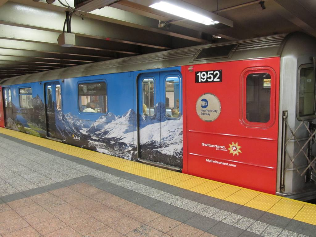 (118k, 1024x768)<br><b>Country:</b> United States<br><b>City:</b> New York<br><b>System:</b> New York City Transit<br><b>Line:</b> IRT Times Square-Grand Central Shuttle<br><b>Location:</b> Grand Central <br><b>Route:</b> S<br><b>Car:</b> R-62A (Bombardier, 1984-1987)  1952 <br><b>Photo by:</b> Robbie Rosenfeld<br><b>Date:</b> 5/3/2012<br><b>Notes:</b> Switzerland tourism ad wrap<br><b>Viewed (this week/total):</b> 0 / 233