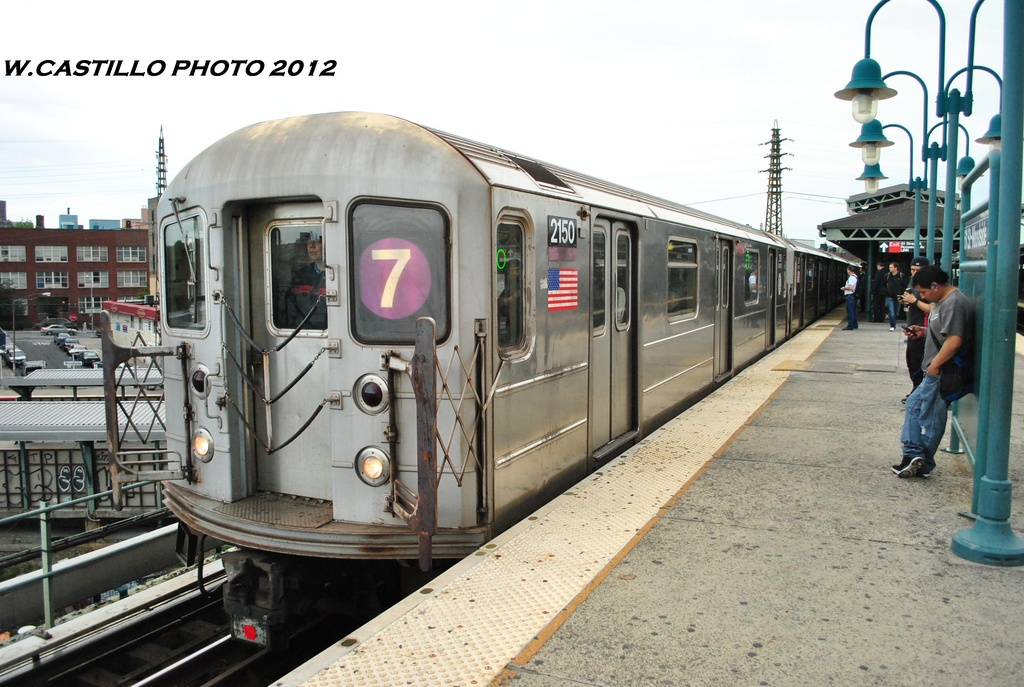 (316k, 1024x687)<br><b>Country:</b> United States<br><b>City:</b> New York<br><b>System:</b> New York City Transit<br><b>Line:</b> IRT Flushing Line<br><b>Location:</b> 61st Street/Woodside <br><b>Route:</b> 7<br><b>Car:</b> R-62A (Bombardier, 1984-1987)  2150 <br><b>Photo by:</b> Wilfredo Castillo<br><b>Date:</b> 5/14/2012<br><b>Viewed (this week/total):</b> 2 / 242