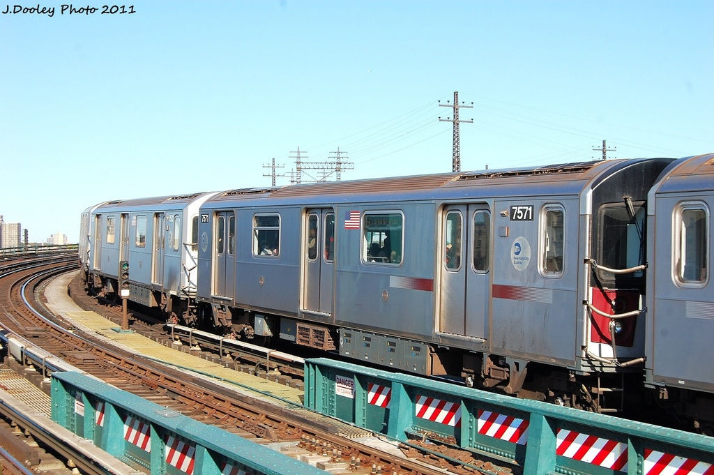 (322k, 1024x681)<br><b>Country:</b> United States<br><b>City:</b> New York<br><b>System:</b> New York City Transit<br><b>Line:</b> IRT Pelham Line<br><b>Location:</b> Whitlock Avenue <br><b>Route:</b> 6<br><b>Car:</b> R-142A (Primary Order, Kawasaki, 1999-2002)  7571 <br><b>Photo by:</b> John Dooley<br><b>Date:</b> 11/5/2011<br><b>Viewed (this week/total):</b> 15 / 474