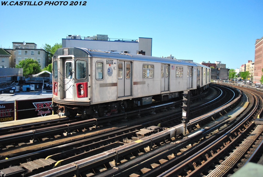 (332k, 1024x687)<br><b>Country:</b> United States<br><b>City:</b> New York<br><b>System:</b> New York City Transit<br><b>Line:</b> IRT White Plains Road Line<br><b>Location:</b> Simpson Street <br><b>Route:</b> 5<br><b>Car:</b> R-142 (Option Order, Bombardier, 2002-2003)  7001 <br><b>Photo by:</b> Wilfredo Castillo<br><b>Date:</b> 5/19/2012<br><b>Viewed (this week/total):</b> 0 / 864