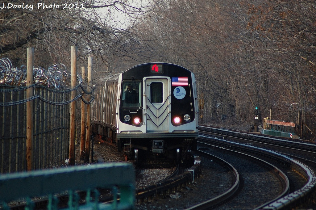 (406k, 1024x680)<br><b>Country:</b> United States<br><b>City:</b> New York<br><b>System:</b> New York City Transit<br><b>Line:</b> BMT Brighton Line<br><b>Location:</b> Sheepshead Bay <br><b>Route:</b> Q<br><b>Car:</b> R-160B (Option 1) (Kawasaki, 2008-2009)  9003 <br><b>Photo by:</b> John Dooley<br><b>Date:</b> 12/31/2011<br><b>Viewed (this week/total):</b> 0 / 297