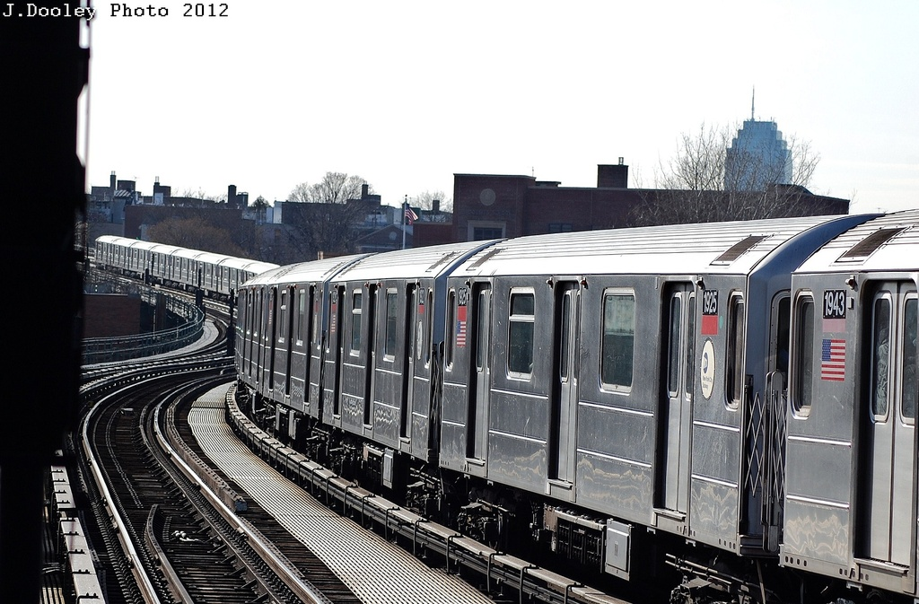 (325k, 1024x673)<br><b>Country:</b> United States<br><b>City:</b> New York<br><b>System:</b> New York City Transit<br><b>Line:</b> IRT Flushing Line<br><b>Location:</b> 61st Street/Woodside <br><b>Route:</b> 7<br><b>Car:</b> R-62A (Bombardier, 1984-1987)  1925 <br><b>Photo by:</b> John Dooley<br><b>Date:</b> 3/6/2012<br><b>Viewed (this week/total):</b> 0 / 1009