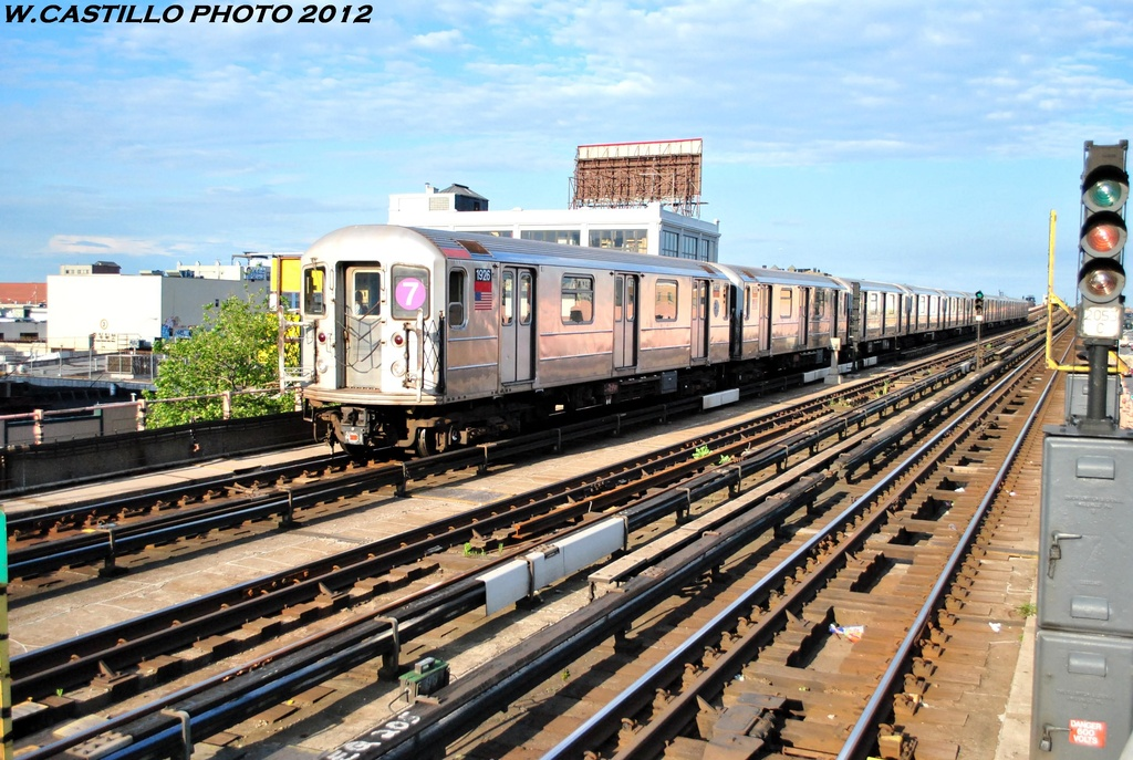(319k, 1024x687)<br><b>Country:</b> United States<br><b>City:</b> New York<br><b>System:</b> New York City Transit<br><b>Line:</b> IRT Flushing Line<br><b>Location:</b> 33rd Street/Rawson Street <br><b>Route:</b> 7<br><b>Car:</b> R-62A (Bombardier, 1984-1987)  1926 <br><b>Photo by:</b> Wilfredo Castillo<br><b>Date:</b> 6/2012<br><b>Viewed (this week/total):</b> 1 / 407