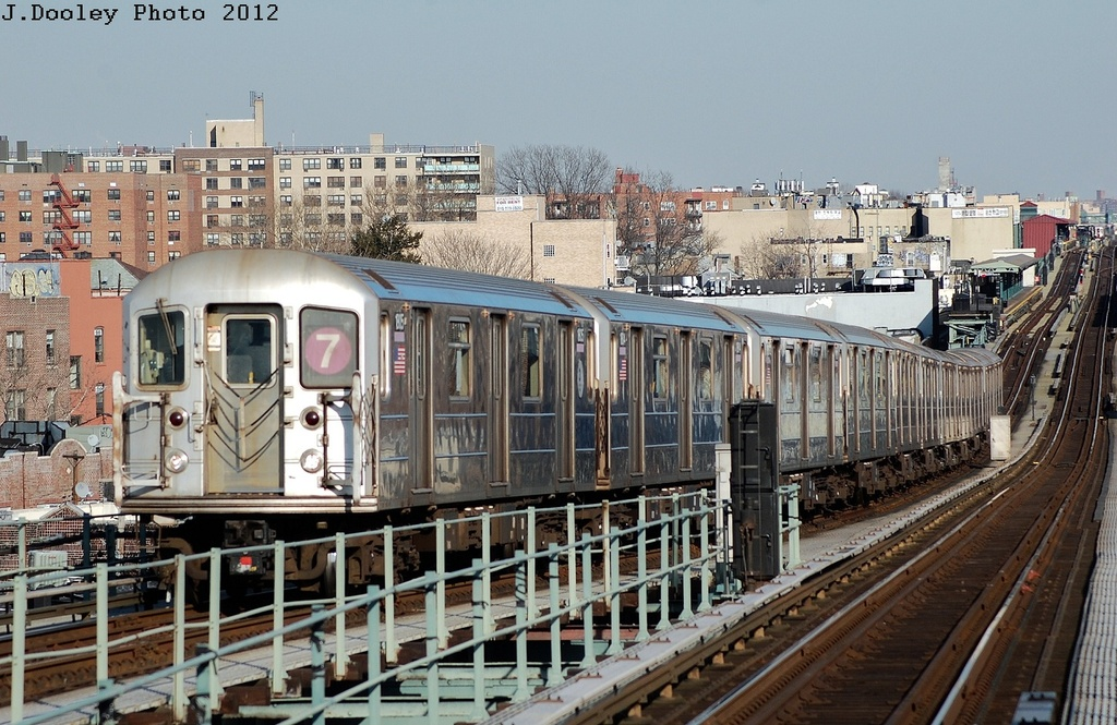 (365k, 1024x665)<br><b>Country:</b> United States<br><b>City:</b> New York<br><b>System:</b> New York City Transit<br><b>Line:</b> IRT Flushing Line<br><b>Location:</b> 61st Street/Woodside <br><b>Route:</b> 7<br><b>Car:</b> R-62A (Bombardier, 1984-1987)  1815 <br><b>Photo by:</b> John Dooley<br><b>Date:</b> 3/6/2012<br><b>Viewed (this week/total):</b> 0 / 170