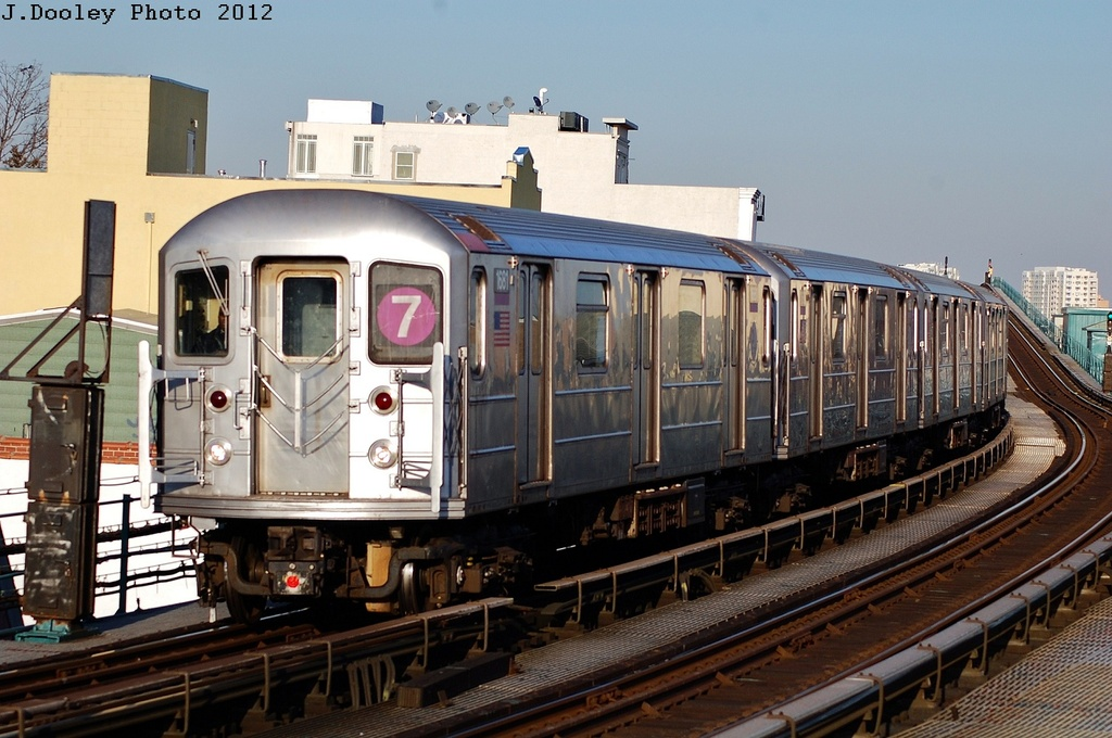 (319k, 1024x680)<br><b>Country:</b> United States<br><b>City:</b> New York<br><b>System:</b> New York City Transit<br><b>Line:</b> IRT Flushing Line<br><b>Location:</b> 103rd Street/Corona Plaza <br><b>Route:</b> 7<br><b>Car:</b> R-62A (Bombardier, 1984-1987)  1681 <br><b>Photo by:</b> John Dooley<br><b>Date:</b> 3/6/2012<br><b>Viewed (this week/total):</b> 5 / 637
