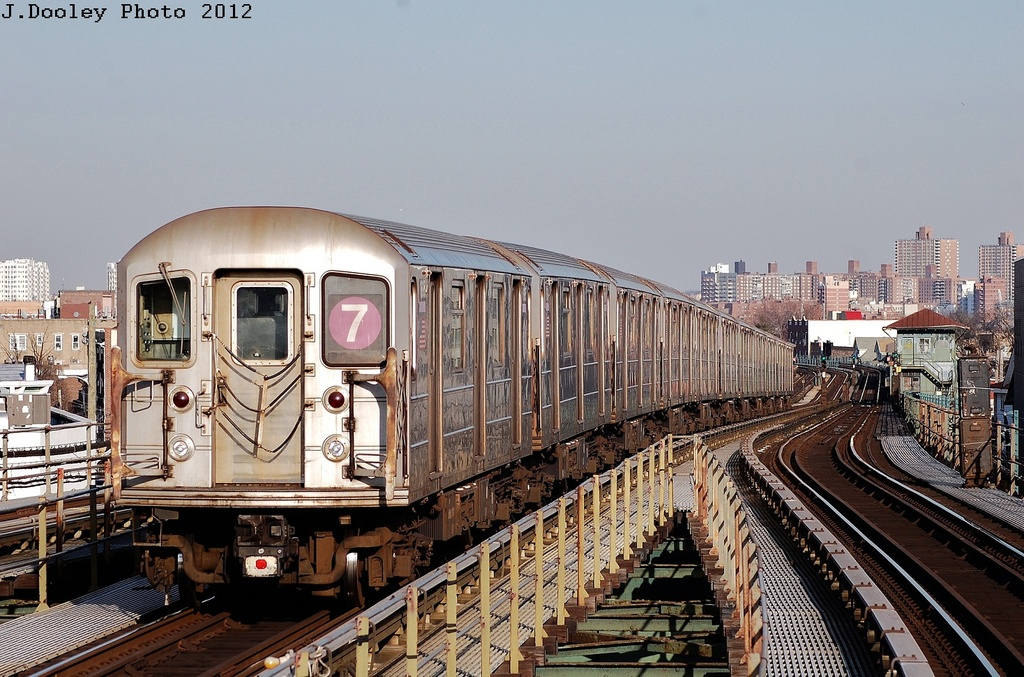 (366k, 1024x677)<br><b>Country:</b> United States<br><b>City:</b> New York<br><b>System:</b> New York City Transit<br><b>Line:</b> IRT Flushing Line<br><b>Location:</b> Junction Boulevard <br><b>Route:</b> 7<br><b>Car:</b> R-62A (Bombardier, 1984-1987)  1695 <br><b>Photo by:</b> John Dooley<br><b>Date:</b> 3/6/2012<br><b>Viewed (this week/total):</b> 0 / 189