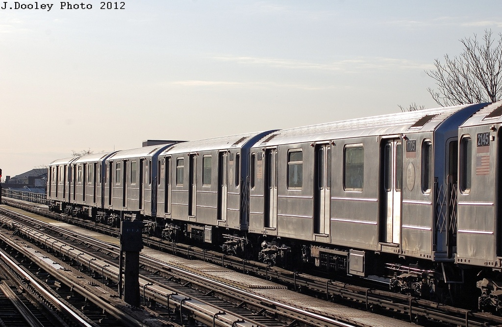 (334k, 1024x667)<br><b>Country:</b> United States<br><b>City:</b> New York<br><b>System:</b> New York City Transit<br><b>Line:</b> IRT Flushing Line<br><b>Location:</b> 103rd Street/Corona Plaza <br><b>Route:</b> 7<br><b>Car:</b> R-62A (Bombardier, 1984-1987)  1705 <br><b>Photo by:</b> John Dooley<br><b>Date:</b> 3/6/2012<br><b>Viewed (this week/total):</b> 0 / 356