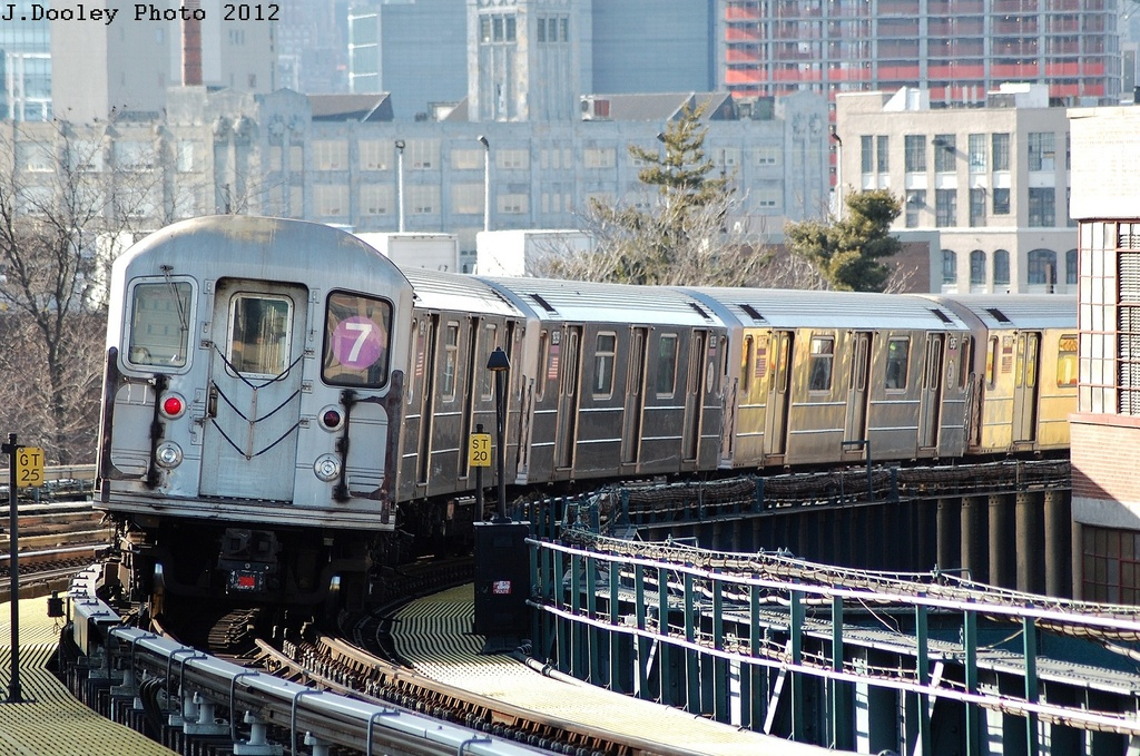 (406k, 1024x679)<br><b>Country:</b> United States<br><b>City:</b> New York<br><b>System:</b> New York City Transit<br><b>Line:</b> IRT Flushing Line<br><b>Location:</b> 33rd Street/Rawson Street <br><b>Route:</b> 7<br><b>Car:</b> R-62A (Bombardier, 1984-1987)  1939 <br><b>Photo by:</b> John Dooley<br><b>Date:</b> 3/6/2012<br><b>Viewed (this week/total):</b> 0 / 666