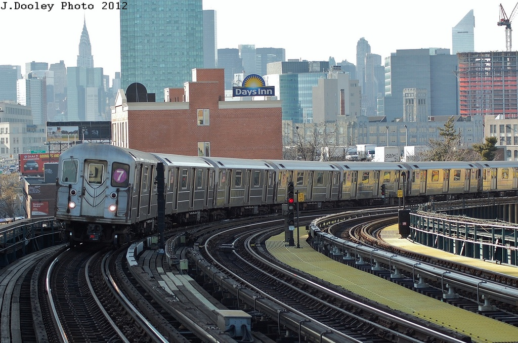 (385k, 1024x678)<br><b>Country:</b> United States<br><b>City:</b> New York<br><b>System:</b> New York City Transit<br><b>Line:</b> IRT Flushing Line<br><b>Location:</b> 33rd Street/Rawson Street <br><b>Route:</b> 7<br><b>Car:</b> R-62A (Bombardier, 1984-1987)  2025 <br><b>Photo by:</b> John Dooley<br><b>Date:</b> 3/6/2012<br><b>Viewed (this week/total):</b> 6 / 628