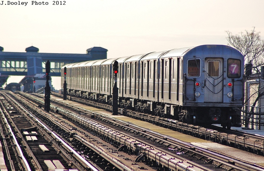 (387k, 1024x665)<br><b>Country:</b> United States<br><b>City:</b> New York<br><b>System:</b> New York City Transit<br><b>Line:</b> IRT Flushing Line<br><b>Location:</b> 103rd Street/Corona Plaza <br><b>Route:</b> 7<br><b>Car:</b> R-62A (Bombardier, 1984-1987)  2111 <br><b>Photo by:</b> John Dooley<br><b>Date:</b> 3/6/2012<br><b>Viewed (this week/total):</b> 2 / 306