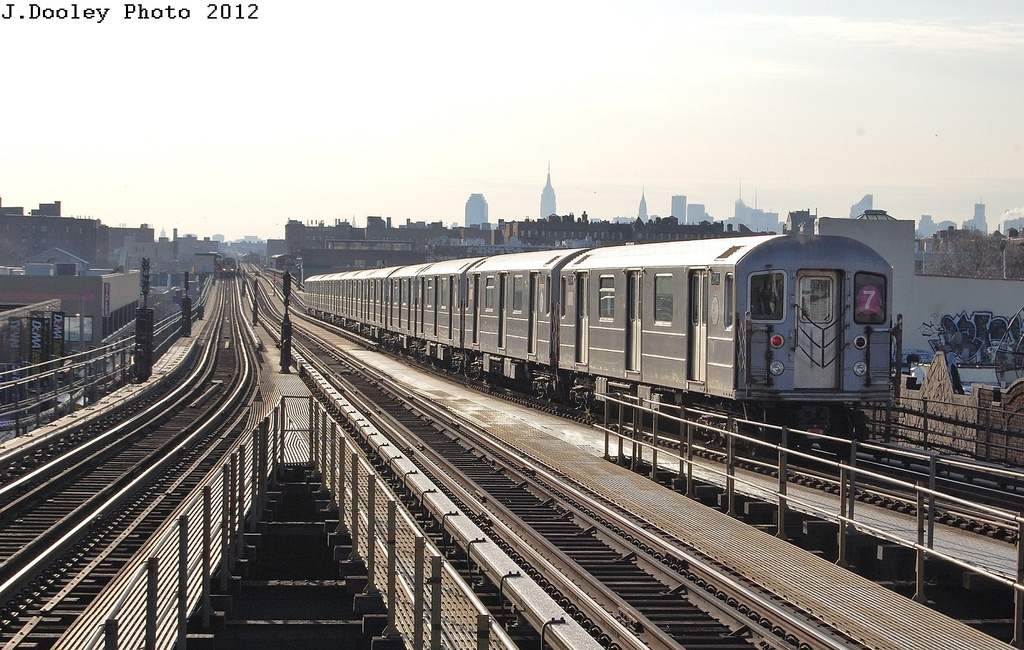 (350k, 1024x650)<br><b>Country:</b> United States<br><b>City:</b> New York<br><b>System:</b> New York City Transit<br><b>Line:</b> IRT Flushing Line<br><b>Location:</b> Junction Boulevard <br><b>Route:</b> 7<br><b>Car:</b> R-62A (Bombardier, 1984-1987)  2114 <br><b>Photo by:</b> John Dooley<br><b>Date:</b> 3/6/2012<br><b>Viewed (this week/total):</b> 4 / 948